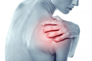Acute pain in a shoulder at the young women.
